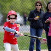 Kid swinging a bat